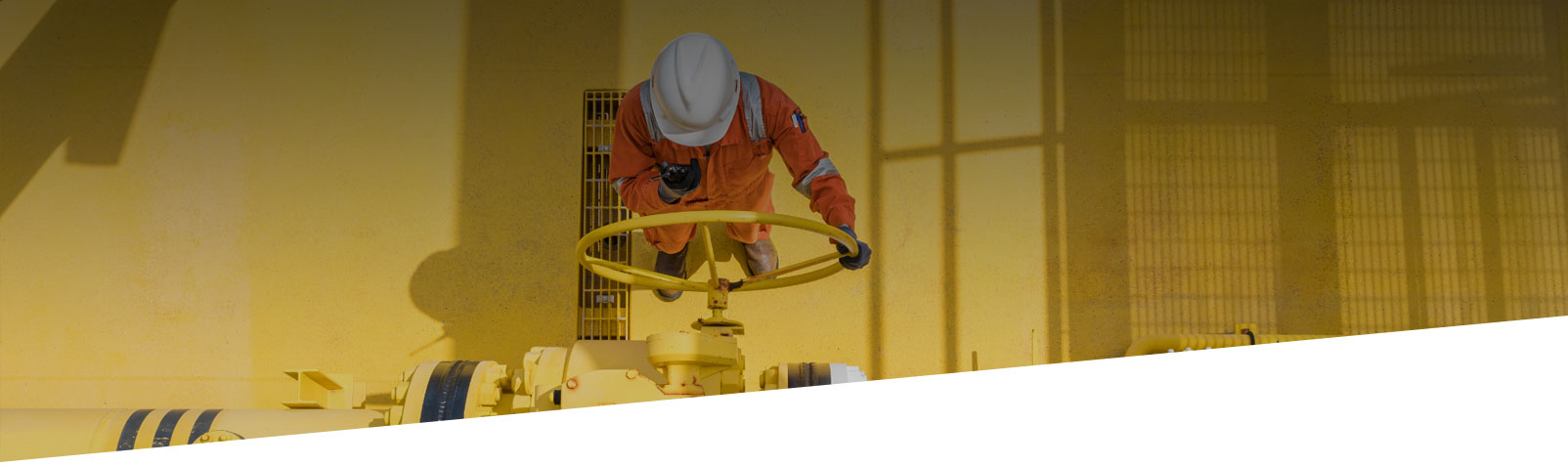 engineer operating oil and gas processing platform